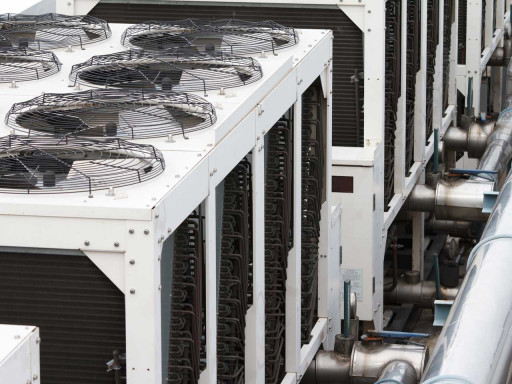 Close up of a roof with fans on top.