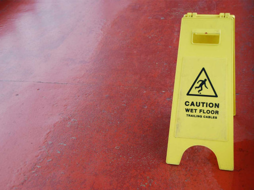 Caution wet floor sign on a red floor.