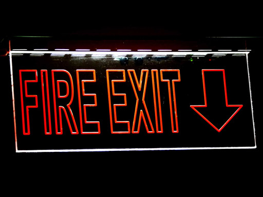 Close up of fire exit in red.